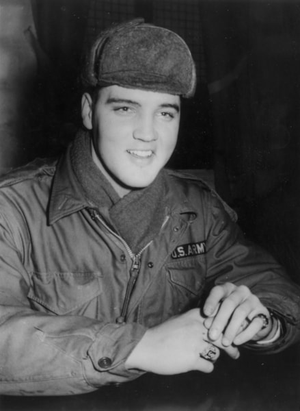 US rock 'n' roll singer Elvis Presley (1935 - 1977) in military uniform during his stint as a US serviceman at the Grafenwoehr exercise camp, Germany.  (Photo by Keystone/Getty Images)