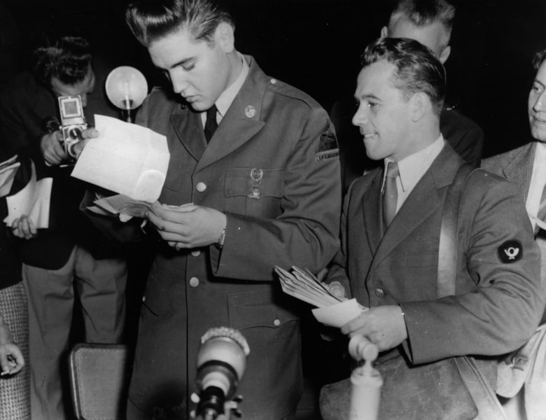 Rock 'n' roll star Elvis Presley (1935 - 1977), now a GI, receives his first bundle of mail at the Friedberg US Army base in Germany, where he will serve sixteen months in the 3rd US Armoured Division.    (Photo by Keystone/Getty Images)