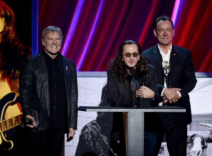 LOS ANGELES, CA - APRIL 18:  (L-R) Inductees Alex Lifeson, Geddy Lee and Neil Peart of Rush speak on stage at the 28th Annual Rock and Roll Hall of Fame Induction Ceremony at Nokia Theatre L.A. Live on April 18, 2013 in Los Angeles, California.  (Photo by Kevin Winter/Getty Images)