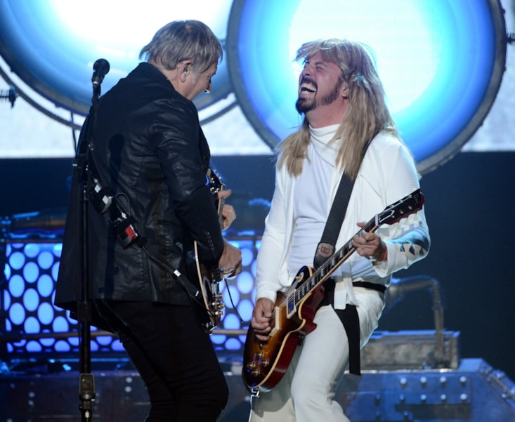 LOS ANGELES, CA - APRIL 18:  (L-R) Inductee Alex Lifeson of Rush and musician Dave Grohl of Foo Fighters perform onstage at the 28th Annual Rock and Roll Hall of Fame Induction Ceremony at Nokia Theatre L.A. Live on April 18, 2013 in Los Angeles, California.  (Photo by Kevin Winter/Getty Images)