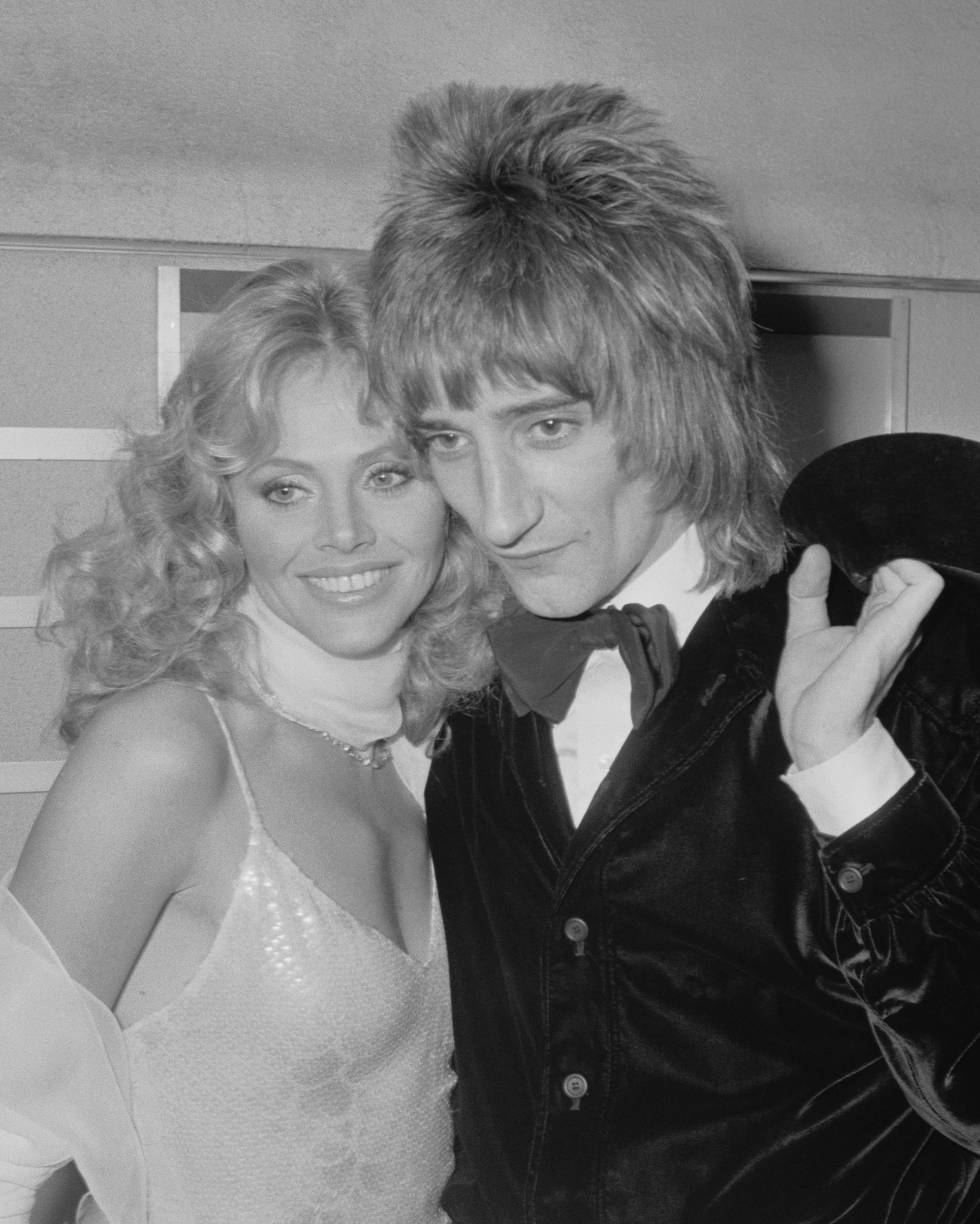 Actress Britt Ekland and her partner, rock star Rod Stewart attend the premiere of the rock opera 'Tommy' at the Leicester Square Theatre, 26th March 1975.  (Photo by Central Press/Hulton Archive/Getty Images)