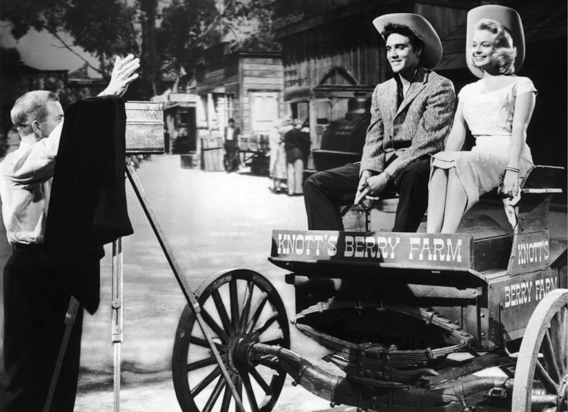Elvis Presley (1935 - 1977) poses on a wagon at Knott's Berry Farm in California, circa 1955. (Photo by Hulton Archive/Getty Images)
