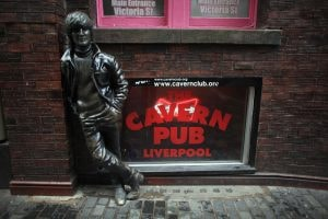 LIVERPOOL, ENGLAND - JANUARY 27: A statue of John Lennon stands outside the Cavern Pub in Mathew Street on January 27, 2012 in Liverpool, England. With six months to go until the opening cermeony of the London 2012 Olympic games Britain's tourist industry is gearing up to cater for the influx of athletes, officials and visitors. (Photo by Christopher Furlong/Getty Images)