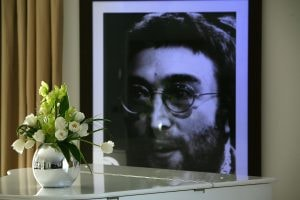 LIVERPOOL, UNITED KINGDOM - FEBRUARY 01: A portrait of John Lennon hangs on the wall of the Lennon Suite at the newly opened Hard Days Night Hotel on February 1, 2008, Liverpool, England. The new Hard Days Night Hotel is a four star boutique hotel set in the heart of Liverpool's 'Beatles Quarter' near the world famous Cavern Club where the Beatles first rose to fame. The hotel features 110 rooms, including luxury and deluxe rooms and has two stunning penthouses - the specially designed Lennon & McCartney suites - the Lennon featuring a white grand piano. Specially commissioned artwork, created by acclaimed Beatles artist Shannon, adorns the 110 guest bedrooms and public rooms. (Photo by Christopher Furlong/Getty Images)